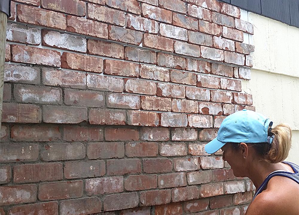 brick installation on exterior studio wall