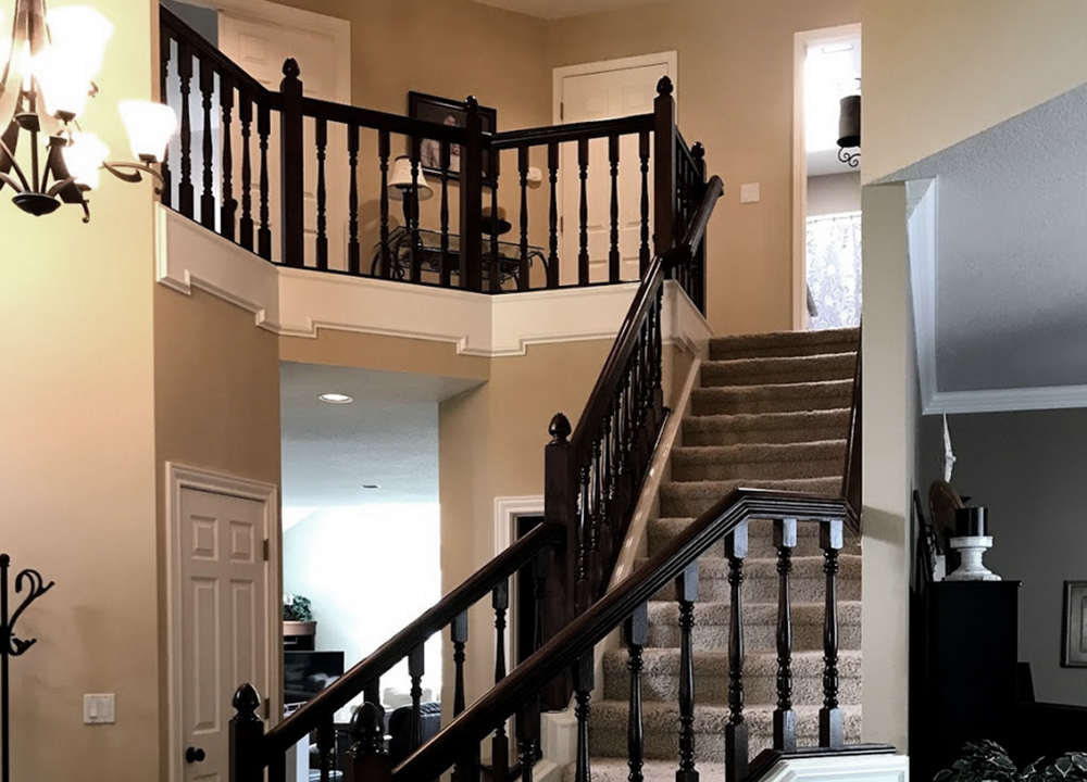 changed oak wood to a beautiful dark wood stain on banisters